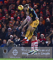Lincoln City's Matt Rhead vies for possession with  Newport County's Fraser Franks<br /> <br /> Photographer Andrew Vaughan/CameraSport<br /> <br /> The EFL Sky Bet League Two - Lincoln City v Newport County - Saturday 22nd December 201 - Sincil Bank - Lincoln<br /> <br /> World Copyright © 2018 CameraSport. All rights reserved. 43 Linden Ave. Countesthorpe. Leicester. England. LE8 5PG - Tel: +44 (0) 116 277 4147 - admin@camerasport.com - www.camerasport.com
