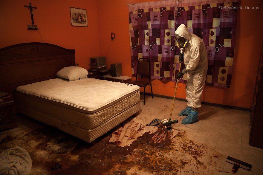 """Donovan carries out a forensic cleaning in Iztacalco, Mexico on October 16, 2015. The decomposed body of a man in his 60s was found in his bedroom a number of days after he died of a heart attack – although the deceased's own family members were unsure exactly how long he had been there. The victim's family remarked that the police had made unfounded insinuations against them, and had sought bribes. As a result they found Donovan's discretion and professionalism to be a welcome contrast. Donovan Tavera, 43, is the director of """"Limpieza Forense México"""", the country's first and so far the only government-accredited forensic cleaning company. Since 2000, Tavera, a self-taught forensic technician, and his family have offered services to clean up homicides, unattended death, suicides, the homes of compulsive hoarders and houses destroyed by fire or flooding. Despite rising violence that has left 70,000 people dead and 23,000 disappeared since 2006, Mexico has only one certified forensic cleaner. As a consequence, the biological hazards associated with crime scenes are going unchecked all around the country. Photo by Bénédicte Desrus"""