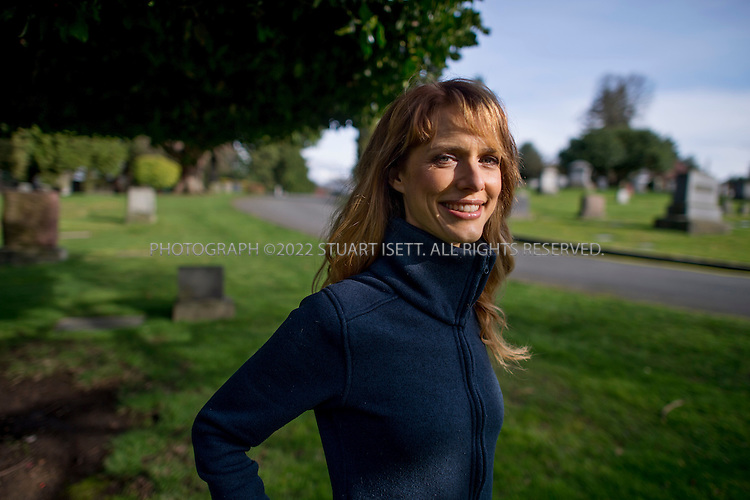 3/18/2012--Seattle, WA, USA..Seattle-based director, Lynn Shelton, posing in Lakeview Cemetery in Seattle's Capitol Hill neighborhood. The cemetery is a location Shelton scouted for her next film, set in Seattle, and is also a place she spent time in while growing up in the city. Martial arts star Bruce Lee is buried in the cemetery...Lynn Shelton known for writing, directing, and producing the 2009 film 'Humpday'. Shelton's film Humpday premiered at Sundance, was acquired by Magnolia Pictures, and was shown at Cannes, SIFF, South by Southwest and other film festivals. It opened in theaters in New York and Seattle July 10, 2009....©2012 Stuart Isett. All rights reserved.