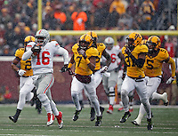 Ohio State Buckeyes quarterback J.T. Barrett (16) scores on a rushing touchdown after getting past Minnesota Golden Gophers defense during the 1st quarter at TCF Bank Stadium in Minneapolis, Minn. on November 15, 2014.  (Dispatch photo by Kyle Robertson)