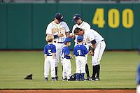 Montgomery Biscuits outfielders Willie Argo (24), Joey Rickard (7), Taylor Motter (10) sign autographs for the stars of the game before a game against the Mississippi Braves on April 21, 2014 at Riverwalk Stadium in Montgomery, Alabama.  Montgomery defeated Mississippi 6-2.  (Mike Janes/Four Seam Images)