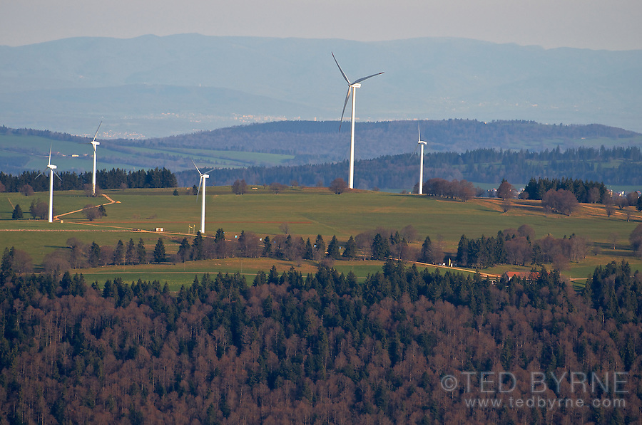Wind turbines on a ridge in the Jura Mountains