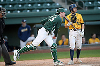 Catcher Scott Combs (35) of the Michigan State Spartans throws out a runner at second in a game against the Merrimack Warriors on Saturday, February 22, 2020, at Fluor Field at the West End in Greenville, South Carolina. Merrimack won, 7-5. (Tom Priddy/Four Seam Images)