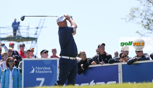 Thomas Bjorn (DEN) grimaces as he drives down the 7th during Round Two of the 2015 Nordea Masters at the PGA Sweden National, Bara, Malmo, Sweden. 05/06/2015. Picture David Lloyd | www.golffile.ie