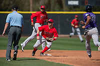 Los Angeles Angels second baseman Zane Gurwitz (71) covers second base on a stolen base attempt by Kennard McDowell (96) during a Minor League Spring Training game against the Colorado Rockies at Tempe Diablo Stadium Complex on March 18, 2018 in Tempe, Arizona. (Zachary Lucy/Four Seam Images)