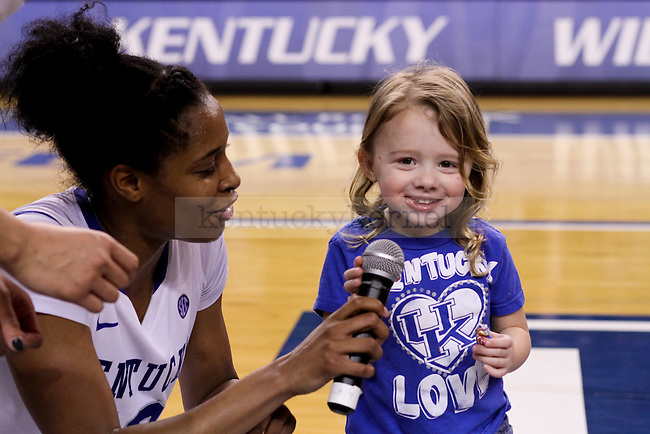 Kentucky senior Bria Goss lets Mathew Mitchell's daughter speak to the crowd after the second half of the UK vs. South Carolina at Memorial Coliseum in Lexington , Ky., on Sunday, March 1, 2015. Photo by Jonathan Krueger | Staff