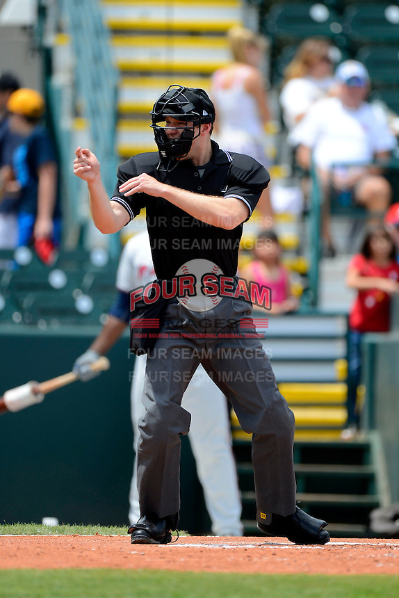 Umpire Charlie Tierney makes a call during a game between the Bradenton Marauders and Fort Myers Miracle at McKechnie Field on April 7, 2013 in Bradenton, Florida.  Fort Myers defeated Bradenton 9-8 in ten innings.  (Mike Janes/Four Seam Images)