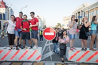 SARANSK, RUSSIA - June 25, 2018: Portugal and Russia fans pose for photographs while walking down Kommunisticheskaya Ulitsa to attend the 2018 FIFA World Cup group stage match between Iran and Portugal at Mordovia Arena.