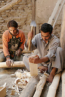 Carpenters inside a historic building. Turquoise Mountain Foundation is working to preserve Afghanistan's traditional crafts and historical buildings. In Kabul, work has started in the historic Murad Khane part of Kabul, and is largely completed in the royal Kart-e-Parwan fort.