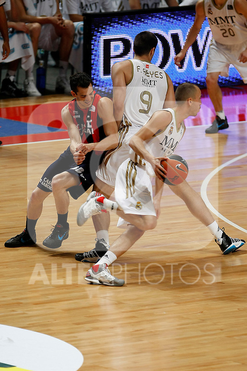 Real Madrid´s Reyes(l) and Sergio Rodriguez and Caja Laboral´s Pau Ribas during La Liga ACB Playoffs semifinal last match, Madrid 2012/June/02..(ALTERPHOTOS/ARNEDO)