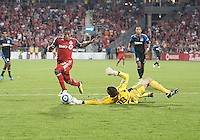 27 August 2011: Toronto FC midfielder Joao Plata #7 makes an attempt on San Jose Earthquakes goaltender Jon Busch #18 during a game between the San Jose Earthquakes and Toronto FC at BMO Field in Toronto..The game ended in a 1-1 draw.