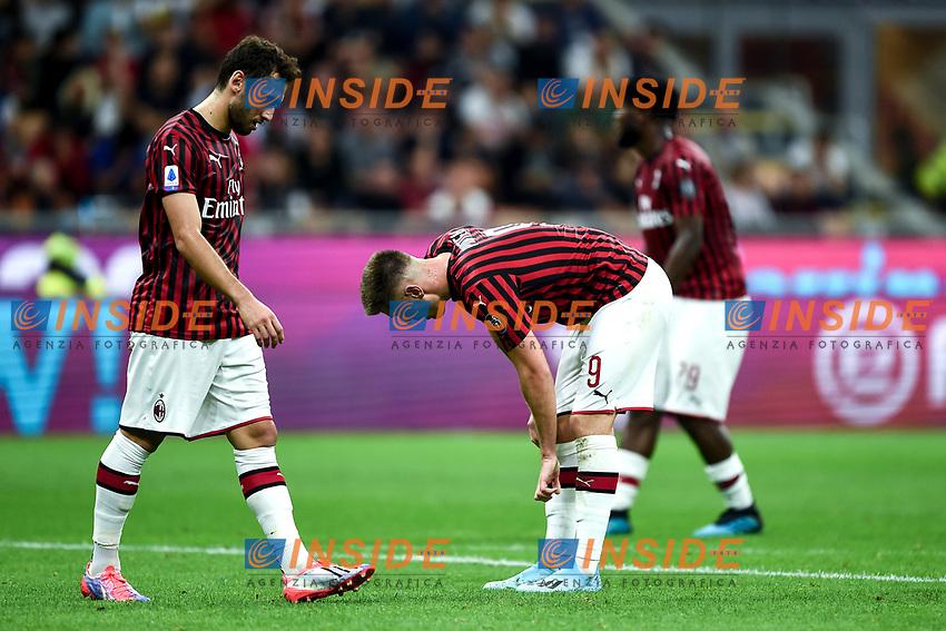 Hakan Calhanoglu of AC Milan , Krzysztof Piatek of AC Milan  dejection <br /> Milano 29/09/2019 Stadio Giuseppe Meazza <br /> Football Serie A 2019/2020 <br /> AC Milan - ACF Fiorentina   <br /> Photo Image Sport / Insidefoto