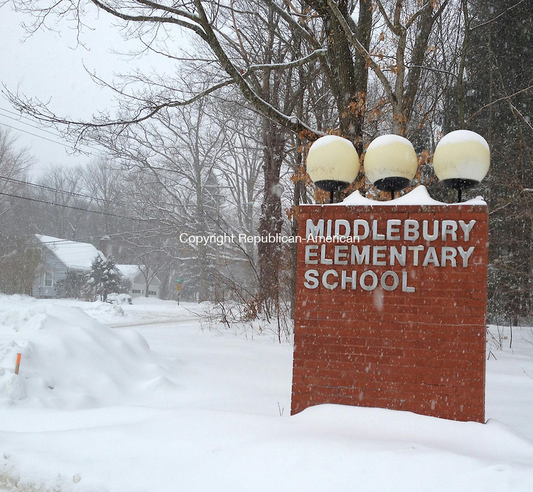 SOUTHBURY, CT - 3 March 2014 - 030314BB01 --- Snows comes down at the entrance to Middlebury Elementary School during a nor'easter last month. Bill Bittar Republican-American