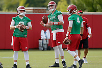 NWA Democrat-Gazette/DAVID GOTTSCHALK   Arkansas Razorback quarterbacks Austin Allen (from left) Cole Kelley and Ty Storey run through drills Friday, July 18, 2017, during practice on campus in Fayetteville.