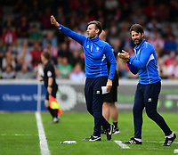 Lincoln City's assistant manager Nicky Cowley, left, and Lincoln City manager Danny Cowley shout instructions to his their from the technical area<br /> <br /> Photographer Chris Vaughan/CameraSport<br /> <br /> The EFL Sky Bet League Two - Lincoln City v Morecambe - Saturday August 12th 2017 - Sincil Bank - Lincoln<br /> <br /> World Copyright &copy; 2017 CameraSport. All rights reserved. 43 Linden Ave. Countesthorpe. Leicester. England. LE8 5PG - Tel: +44 (0) 116 277 4147 - admin@camerasport.com - www.camerasport.com