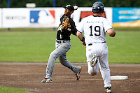 03 September 2011: Roeland JR. Henrique of L&D Amsterdam Pirates throws to first base for the double play during game 1 of the 2011 Holland Series won 5-4 in inning number 14 by L&D Amsterdam Pirates over Vaessen Pioniers, in Hoofddorp, Netherlands.