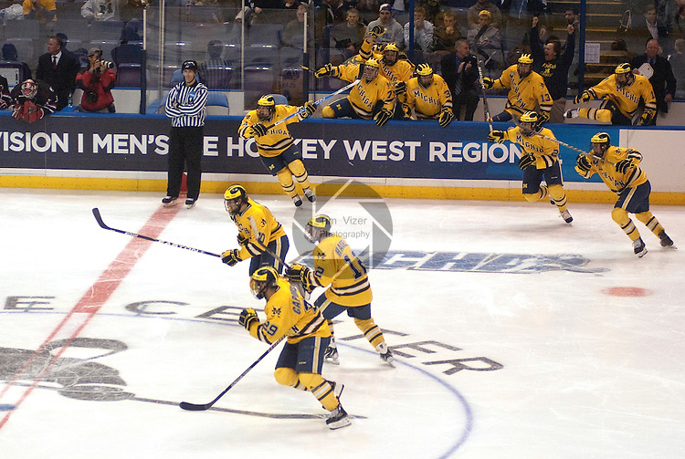 March 25,  2011            Members of the Michigan hockey team leap onto the ice after a ruling was made that an iffy goal actually counted, giving them the win.  The University of Michigan Wolverines defeated the University of Nebraska -Omaha Mavericks in a sudden death overtime period 3-2, after regulation time ended with a 2-2 tie.  The officials took several minutes to make a ruling on a goal, which resulted in the Michigan team's win. They will advance after the win in the first semifinal game at the NCAA Division 1 Men's West Regional Hockey Tournament, played on Friday March 25, 2011 at the Scottrade Center in downtown St. Louis.