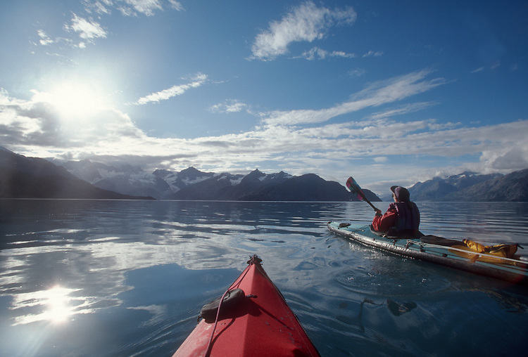 Alaska, Glacier Bay National Park, Kayakers paddle John Hopkins Inlet in rare sunshine..