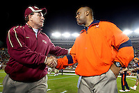 TALLAHASSEE, FL 11/19/11-FSU-UVA111911 CH-Florida State's Head Coach Jimbo Fisher, left, greets Virginia Head Coach Mike London prior to the game Saturday at Doak Campbell Stadium in Tallahassee. .COLIN HACKLEY PHOTO
