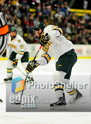 5 February 2011: University of Vermont Catamount defenseman Anders Franzon, a Sophomore from Plattsburgh, NY shoots to score Vermont's 4th goal against the Providence College Friars at Gutterson Fieldhouse in Burlington, Vermont. The Catamounts defeated the Friars 7-1 in the second game of their weekend series. Mandatory Credit: Ed Wolfstein Photo