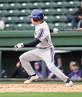 Infielder Trevor Stevens (3) of the Northwestern Wildcats hits in a game against the Furman University Paladins on Saturday, February 16, 2013, at Fluor Field in Greenville, South Carolina. The game was cancelled in the fifth inning due to snow. (Tom Priddy/Four Seam Images)