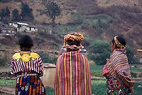 Three Maya women wearing traditional clothing or traje in the village of Zunil near Quetzaltenango