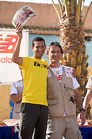 The Marathon des Sables is a 6-day endurance race of 243 km equivalant to 5 1/2 marathons. It plays out in the Sahara Desert, southern Morocco, up and down sand dunes, along dried lakes and riverbeds, past ruins, always under the baking sun. Competitors at the Marathon des Sables expierence mid-day temperatures of up to 120°F. They are running or walking on even rocky, stony ground as well as 15-20% of the distance being in sand dunes. In addition to that, competitors have to carry everything they will need for the duration of the race on their backs in a rucksack. Water is rationed and handed out at each checkpoint. It is the hardest footrace on earth...Der Marathon des Sables in der marrokanischen Sahara gilt als der wohl härteste und bekannteste Wüstelauf der Welt. Ein Ultralauf über 243 Kilometer, der in 6 Etappen zwischen 27 und 82 Kilometer in 7 Tagen gelaufen wird. Die längste Etappe geht bis spät in die Nacht hinein. Die Läufer tragen ihre Ausrüstung und Verpflegung für das ganze Rennen im Rucksack. Lediglich Wasser (9 Liter pro Tag) gibt es an den Checkpoints. Die Teilnehmer laufen über Sanddünen, steiniges Gelände und steile Berganstiege. Die Hitze kann bis zu 50 Grad Celsius betragen. ,Samir Akhdar