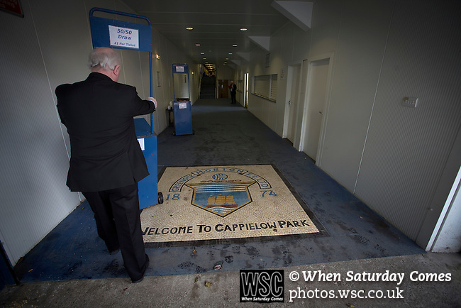 Greenock Morton 2 Stranraer 0, 21/02/2015. Cappielow Park, Greenock. A club official moving equipment over a floor mosaic with the home club's crest inside the stadium, pictured before Greenock Morton take on Stranraer in a Scottish League One match at Cappielow Park, Greenock. The match was between the top two teams in Scotland's third tier, with Morton winning by two goals to nil. The attendance was 1,921, above average for Morton's games during the 2014-15 season so far. Photo by Colin McPherson.
