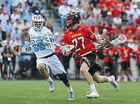Baltimore, MD - April 28, 2018: Maryland Terrapins Christian Zawadski (27) attempts a shot during game between John Hopkins and Maryland at  Homewood Field in Baltimore, MD.  (Photo by Elliott Brown/Media Images International)