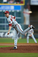 Arkansas Razorbacks starting pitcher Patrick Wicklander (33) follows through on his delivery against the Texas Longhorns in game six of the 2020 Shriners Hospitals for Children College Classic at Minute Maid Park on February 28, 2020 in Houston, Texas. The Longhorns defeated the Razorbacks 8-7. (Brian Westerholt/Four Seam Images)