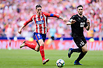 Fernando Torres of Atletico de Madrid (L) in action against Paulo Oliveira of SD Eibar (R) during the La Liga match between Atletico Madrid and Eibar at Wanda Metropolitano Stadium on May 20, 2018 in Madrid, Spain. Photo by Diego Souto / Power Sport Images