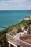 EXUMA, Bahamas. A balcony overlooking the water at Fowl Cay Resort.