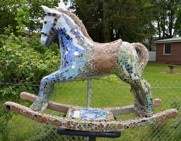"""A view of, """"The Keltic"""" by artist, Georgette Eagleson, one of the 35 Artist painted Rocking Horses on display around Saugerties, NY as part of the Chamber of Commerce sponsored Art in the Village Project titled """"Rockin' Around Saugerties."""" This photo taken on Friday, May 26, 2017. Photo by Jim Peppler. Copyright/Jim Peppler-2017."""