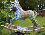 "A view of, ""The Keltic"" by artist, Georgette Eagleson, one of the 35 Artist painted Rocking Horses on display around Saugerties, NY as part of the Chamber of Commerce sponsored Art in the Village Project titled ""Rockin' Around Saugerties."" This photo taken on Friday, May 26, 2017. Photo by Jim Peppler. Copyright/Jim Peppler-2017."