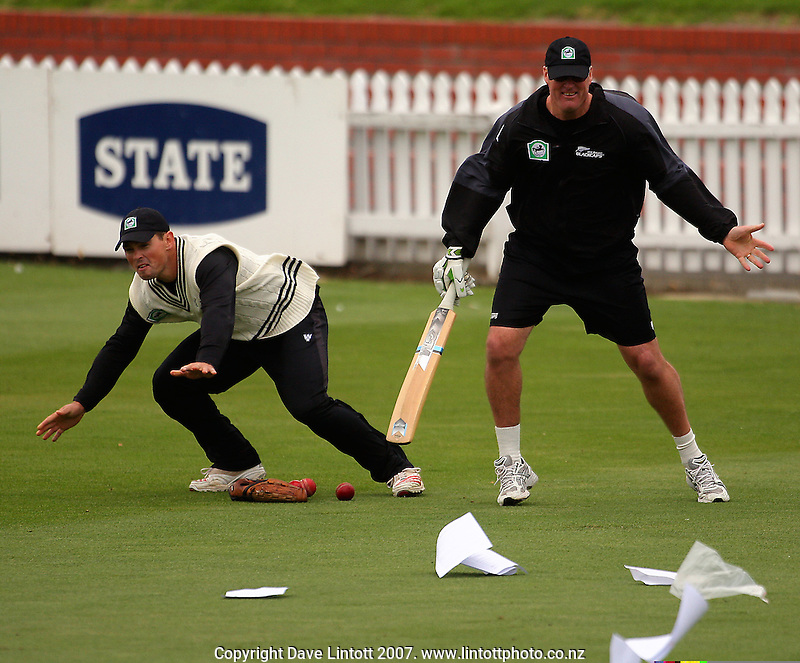 Matthew Bell and John Bracewell try to stop paperwork from blowing away during the Black Caps nets practice in the build-up for the National Bank Test Match Series second test between New Zealand Black Caps and England at the Allied Prime Basin Reserve,Wellington, New Zealand on Tuesday, 11 March 2008. Photo: Dave Lintott / lintottphoto.co.nz