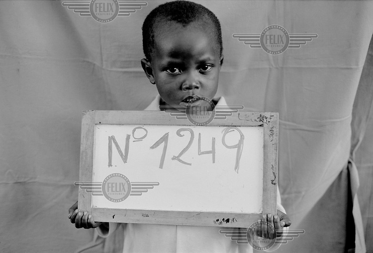 A boy registers at the Lumasi refugee camp. He was separated from his parents while escaping the Rwanda.genocide..