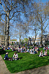 Young people enjoying the sunshine in Hoxton Square, London, England