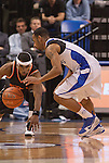 March 24,  2010                  Princeton guard Douglas Davis (20) lunges for the ball dribbled by Saint Louis guard Kwamain Mitchell (3) in the second half.   The Saint Louis University Billikens defeated the Princeton Tigers 69-59 in a semifinal game of the College Basketball Invitational Tournament on Wednesday March 24, 2010 at the Chaifetz Arena, on the campus of Saint Louis University.  They advance in the post-season CBI Tournament and will play Virginia Commonwealth University on Monday 29, 2010 in Richmond, VA.