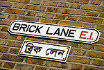 Brick Lane street sign in English and Bengali, London, England