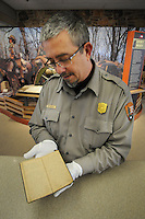 NWA Media/Spencer Tirey - Troy Banzhaf, supervisory park ranger at Pea Ridge National Military Park shows a diary that was donated to the park that has a description of the battle there, Monday Dec. 8, 2014.