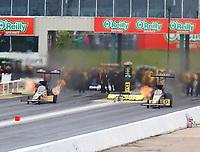 May 20, 2017; Topeka, KS, USA; NHRA top fuel driver Leah Pritchett (left) races alongside Tony Schumacher during qualifying for the Heartland Nationals at Heartland Park Topeka. Mandatory Credit: Mark J. Rebilas-USA TODAY Sports