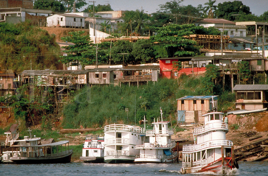 Dozens of worn, and weathered homes built on the riverside, in Manaus, Brazil. Manaus Amazonas Brazil Northwest region.