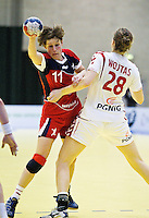 22 MAR 2012 - LOUGHBOROUGH, GBR - Great Britain's Lyn Byl (GBR) (on left in red and blue) tries to get past Poland's Alina Wojtas (POL) (on the right in white and red) during the women's 2012 European Handball Championships qualification match at Loughborough University in Loughborough, Great Britain .(PHOTO (C) 2012 NIGEL FARROW)