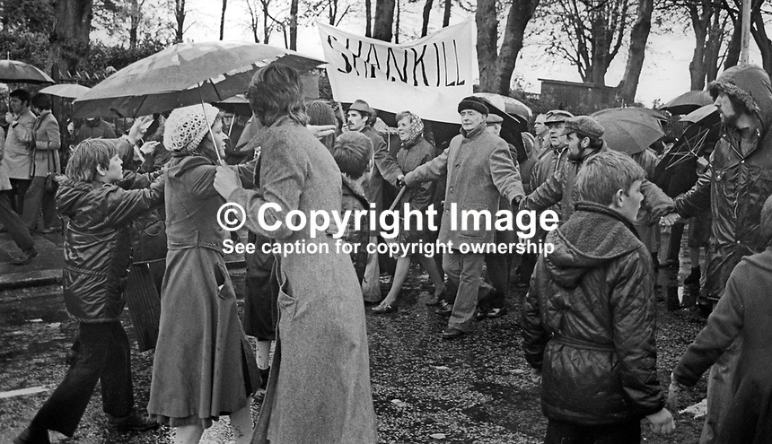 Peace People March along the Falls Road, Belfast, N Ireland, UK, 23rd October 1976 - Peace marchers join hands as they are confronted by Sinn Fein opponents. 197610230506w<br /> <br /> Copyright Image from Victor Patterson, 54 Dorchester Park, Belfast, UK, BT9 6RJ<br /> <br /> t: +44 28 9066 1296<br /> m: +44 7802 353836<br /> <br /> e1: victorpatterson@me.com<br /> e2: victorpatterson@gmail.com<br /> <br /> IMPORTANT: My Terms and Conditions of Business are at www.victorpatterson.com