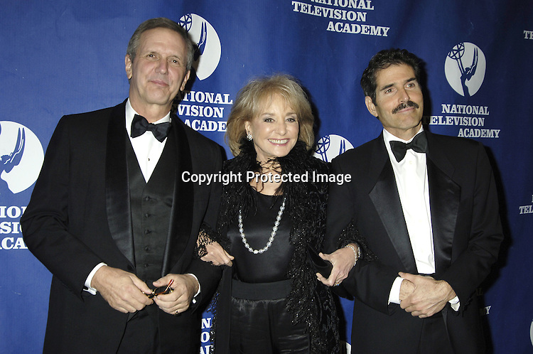Charlie Gibson, Barbara Walters and John Stossel ..at The National Television Academy Dinner Honoring Robert Iger on October 20, 2005 at The Marriott Marquis Hotel. ..Photo by Robin Platzer, Twin Images
