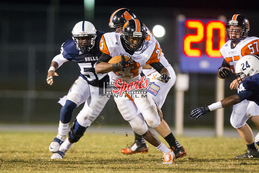 Isaiah Williams (23) of the Northwest Cabarrus Trojans looks for running room during second half action against the Hickory Ridge Ragin' Bulls at Hickory Ridge High School on October 17, 2014 in Harrisburg, North Carolina.  The Ragin' Bulls defeated the Trojans 34-6.  (Brian Westerholt/Sports On Film)