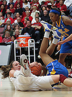 STANFORD, CA - January 20, 2011: Kayla Pedersen dives for a loose ball during Stanford's 64-38 victory over UCLA at Stanford, California on January 20, 2011.