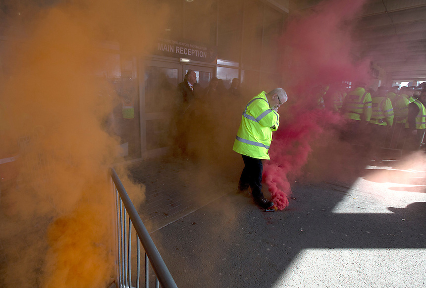 Smoke flares are thrown as Blackpool fans protest outside Bloomfield Road against the owner Owen John Oyston and the way the club is being run<br /> <br /> Photographer Stephen White/CameraSport<br /> <br /> Football - The Football League Sky Bet Championship - Blackpool v Leeds United - Saturday 21st March 2015 - Bloomfield Road - Blackpool<br /> <br /> &copy; CameraSport - 43 Linden Ave. Countesthorpe. Leicester. England. LE8 5PG - Tel: +44 (0) 116 277 4147 - admin@camerasport.com - www.camerasport.com