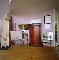 A corner of the living room with a stove designed by Melnikov