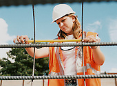 Civil Engineering student on work placement checks the spacing on some metal formwork.
